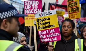 Protesters in London oppose British far-right activist Tommy Robinson.