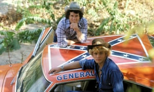 Tom Wopat and John Schneider with the General Lee car from the Dukes of Hazzard.