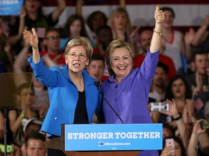 Clinton stands with Elizabeth Warren at a campaign rally in Cincinnati in June 2016