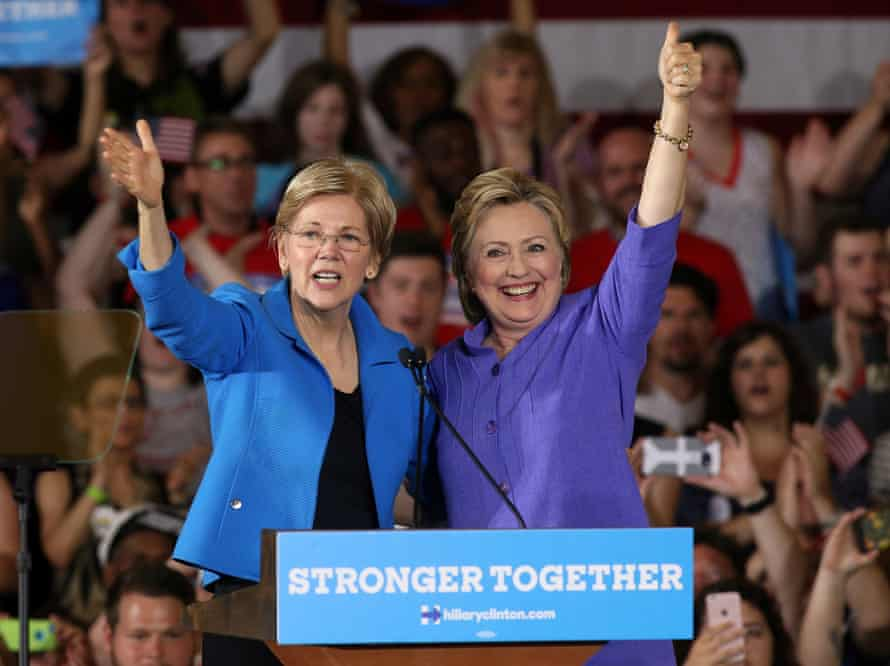 Clinton stands with Elizabeth Warren at a campaign rally in Cincinnati in June 2016