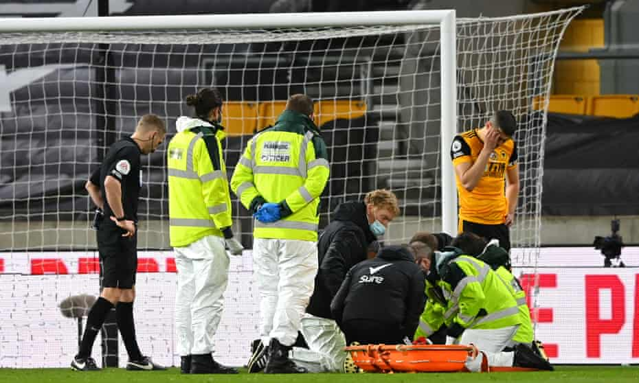 Medical staff treat the unseen Rui Patrício after his collision with his teammate Conor Coady during the 1-0 defeat by Liverpool