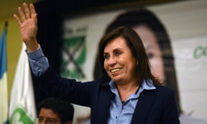Sandra Torres waves to supporters in Guatemala City earlier this month.