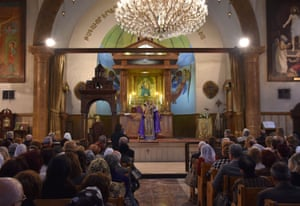 Christians attend a mass at the Armenian Orthodox church of the Virgin Mary