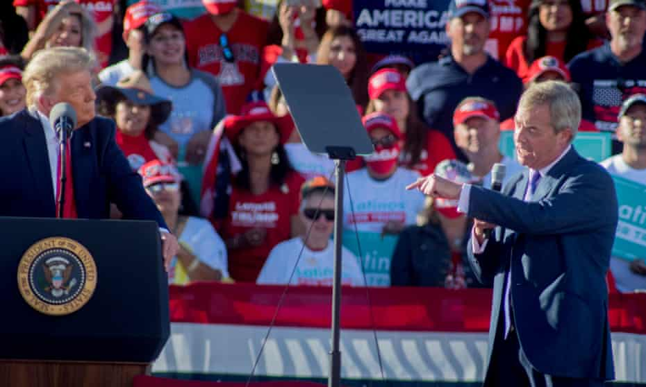 Nigel Farage (right) speaks at Trump's election rally in Arizona.