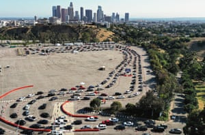 Cars lined up to be tested for COVID-19 in a parking lot at Dodger Stadium amid the coronavirus pandemic in Los Angeles