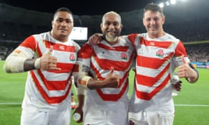 Japan's Asaeli Ai Valu, Isileli Nakajima and Luke Thompson celebrate the famous 19-12 victory over Ireland