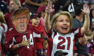 Arizona Cardinals fans wear masks of presidential candidates Donald Trump and Hillary Clinton in October 2016.