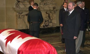 Fidel Castro pays his respects to former Canadian prime minister Pierre Trudeau during the lying-in-state ceremony in Montreal on 2 October, 2000.