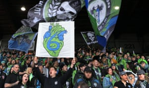 Seattle Sounders FC fans cheer before an MLS game. soccer has exploded in the city, and attendance at Sounders games averages 40,000.