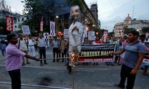 Protesters burn an effigy of Kuldeep Singh Sengar in Kolkata.