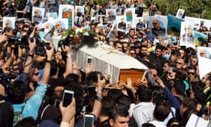 Iranians carry the coffin of the Iranian film director Abbas Kiarostami at a funeral ceremony in Tehran, Iran.