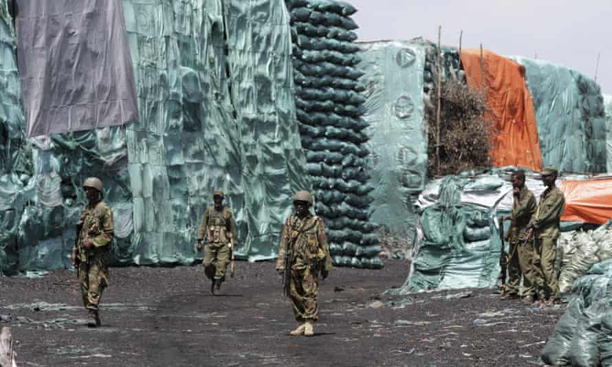 Soldiers form the Kenya Defence Forces and the Somali Transitional Federal Government patrolling a charcoal depository in Burgabo, Somalia, in 2011.
