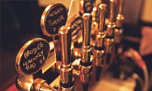 a row of beer taps in a pub