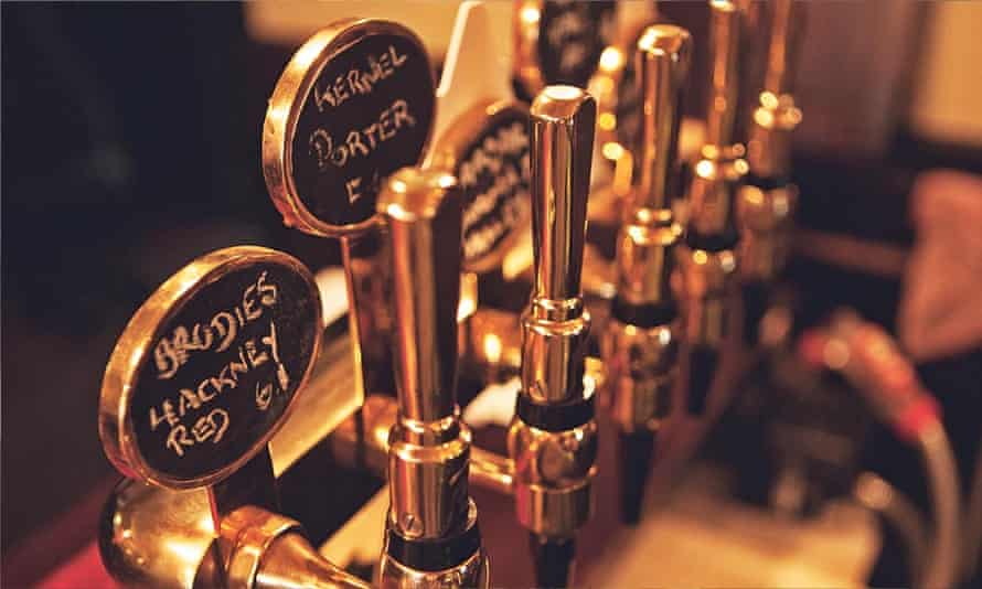 Pumps labelled with craft beer brews at the Old Fountain, Shoreditch, London