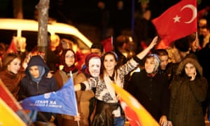 Supporters celebrate outside the AKP headquarters in Istanbul.