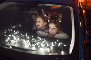 Perth, ScotlandTwo girls look out of the car window as pupils, parents and guardians attend the Kilgarston Girls School drive-in movie night