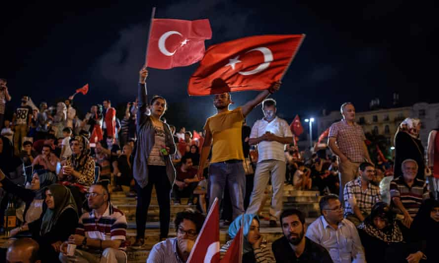 Demonstrators wave Turkish flags at Taksim square in Istanbul during a rally in support to the Turkish government following a failed coup attempt.
