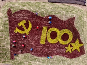 Lianyungan, China  Workers display a flower arrangement marking the 100th anniversary of the founding of the Communist Party of China, in Jiangsu province