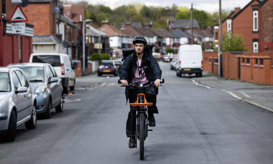 Weezy deliver rider Sean Holehouse out on an ebike delivering an order.