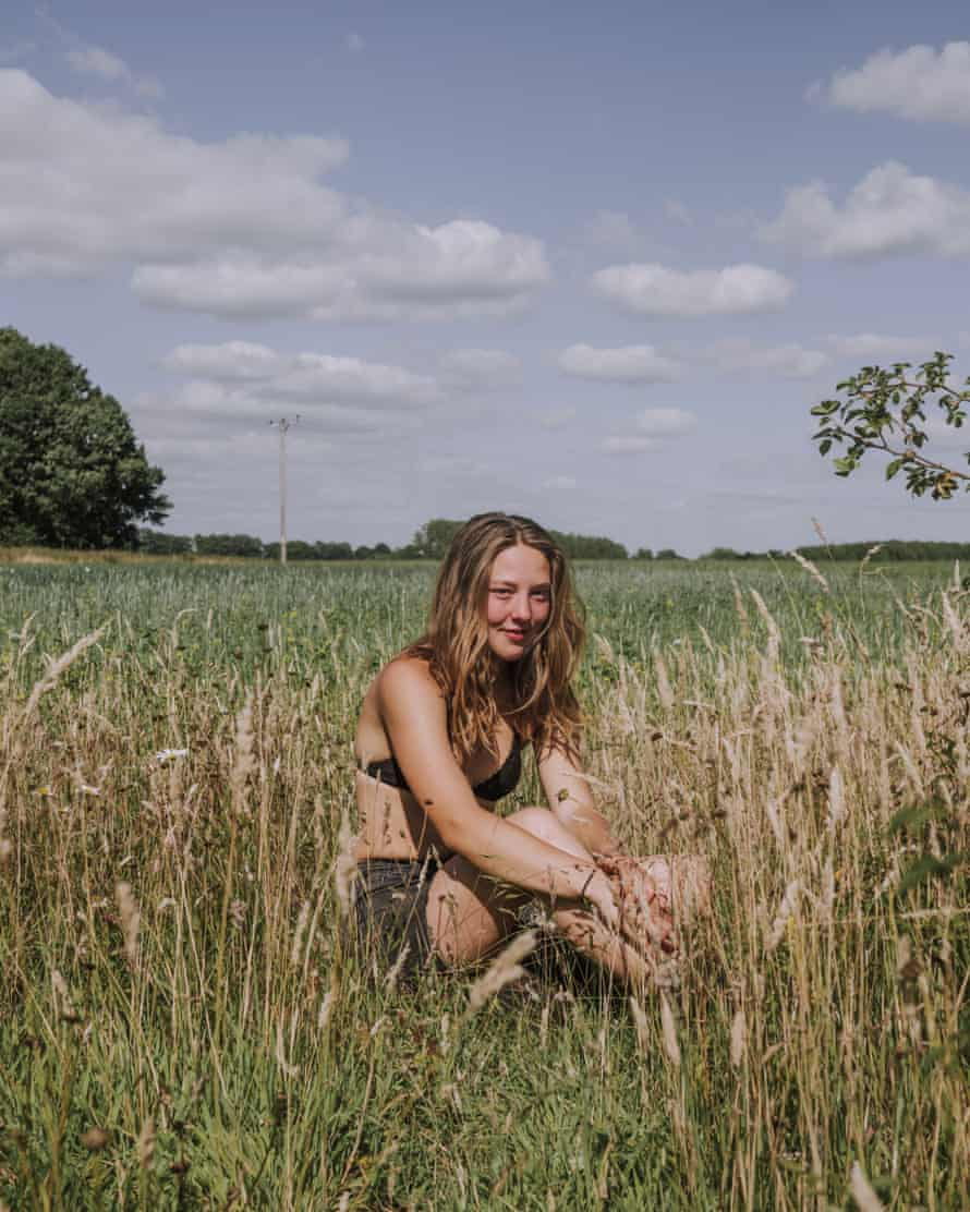 Portrait of Becca in a field with wild flowers