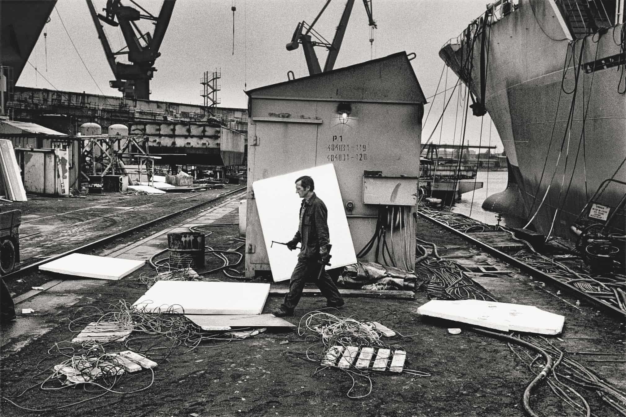 A worker leaving a ship in construction in Gdansk Shipyard, 1990
