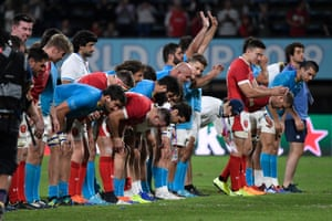 Wales and Uruguay players bow to the crowd after the match.