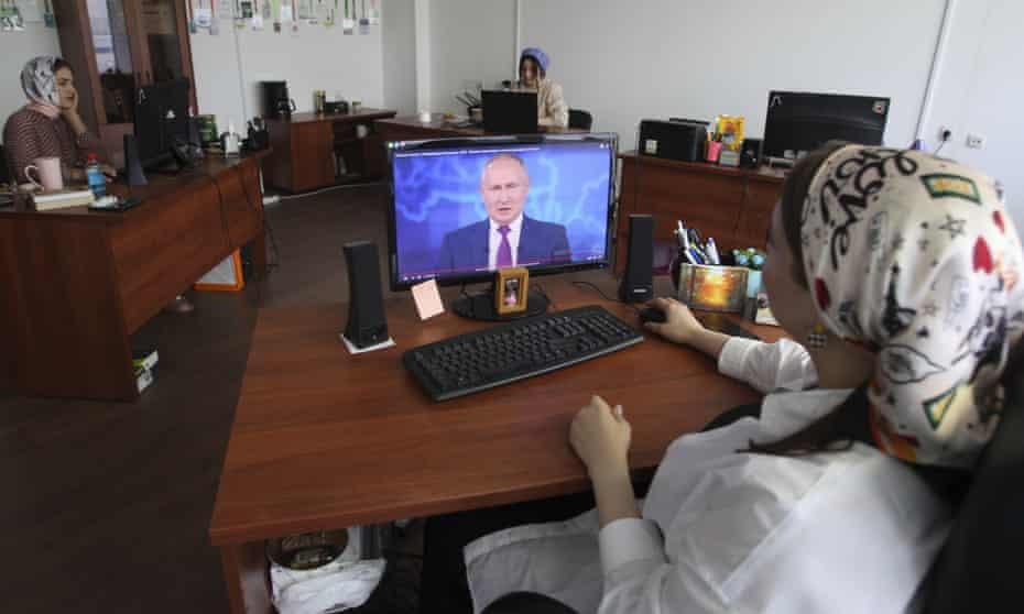 Watching Putin on computer screen