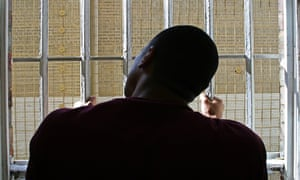 A man in a cell at Wandsworth prison