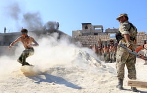 Syrian rebel fighters from the recently formed National Liberation Front undertake military training in anticipation of an upcoming government forces offensive in Idlib province