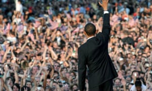 Barack Obama greets the audience from the stage following his speech in Berlin in July 2008.