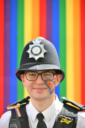 A Metropolitan police officer with rainbows and a love heart
