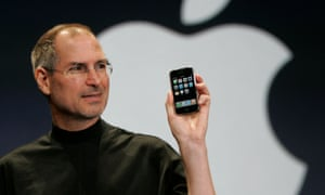 Apple CEO Steve Jobs holds up the new iPhone at MacWorld Conference