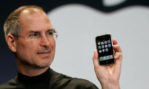 Steve Jobs holds an iPhone