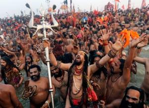 Allahabad, IndiaNaga sadhus, or naked holy men, take a holy bath, at the Sangam river, the confluence of three of the holiest rivers in Hindu mythology, the Ganga, the Yamuna and the Saraswati, during Kumbh Mela