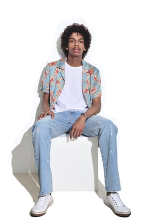 man in print shirt and jeans