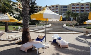 Deck chairs with towels lie abandoned at the Imperial Marhaba Hotel after Friday's attacks