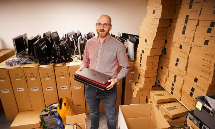 Steven Lightfoot, of Pudsey Computers, west Yorkshire, surrounded by laptops in boxes