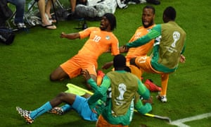 Gervinho enjoys the moment with Didier Drogba and others after scoring for Ivory Coast against Japan at the 2014 World Cup.