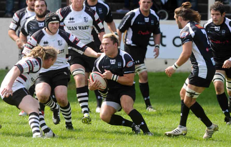 Gerwyn Price looks for a way through the Pontypridd defence when playing rugby union for Cross Keys in 2012
