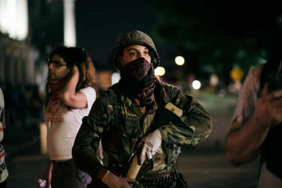 A so-called militia man shows up on the protester side and offers armed escorts to a safe position in Kenosha, Wisconsin in August.