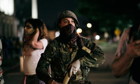 A so called militia man at protests in Kenosha, Wisconsin, on 25 August 2020.