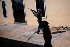 Ayahualtempa, Mexico Children are taught to use weapons by the community police force at a basketball court in the village of Ayahualtempa, Guerrero state. The vigilante group trains children as young as five to protect themselves from drug-related criminal gangs operating in the area