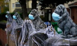 A home in Warrington, England is decorated for Halloween with face masks and synthetic cobwebs as the area enters Covid-19 Tier 3 'Very High' lockdown restrictions.