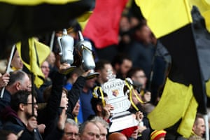 A cup tie isn't a cup tie without replica trophies in the crowd.