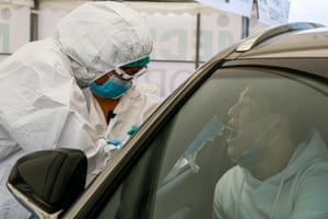 A healthcare worker gives a Covid-19 test to a medical staff near Halyk Arena in Almaty, on 5 July 2020 as Kazakhstan imposed a second round of nationwide restrictions to counter a huge surge in coronavirus cases.