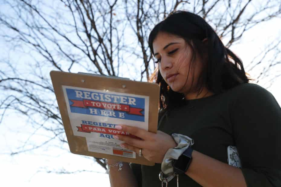 Karina Shumate, 21, fills out a voter registration form in Richardson, Texas, in January. Young voters helped drive high voter participation in the state.