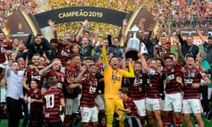 Players of Brazil's Flamengo celebrate with the trophy after winning the Copa Libertadores final.