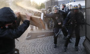 Anti-fascists clash with police officers as they demonstrate in Paris.