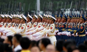 Members of the honour guard march past participants at the event marking the 100th founding anniversary of the Communist Party of China