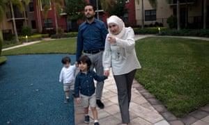 TPS holders Mohammad Alala and his wife, Dania, walk near their home in Miramar, Florida.